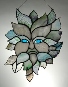 Winter Greenman stained glass hanging by Maid on the Moon Studio
