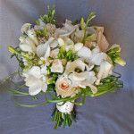 white ivory cream dfendrobium orchid freesia rose calgary wedding flowers bridal party bouquet