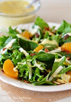 Spinach Salad with bacon, sliced almonds and mandarin oranges!