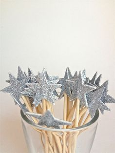 Two stars punched out on card stock, toothpick and glitter