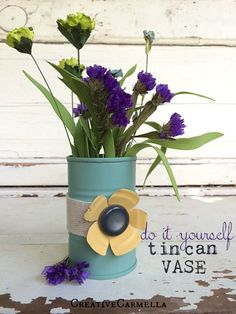 I love the flower made from the tin can lid! Tin Can Vase for Flowers or Art Supplies www.orsoshesays.com #crafts