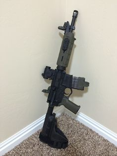 Custom AR pistol with Spikes upper receiver, bolt carrier group, and buffer tube assembly. Also includes Voodoo Innovations melonited 11.5 barrel, AAC shorty compentasor (loud and fiery), PRI gasblock, Yankee hill tube, Sig SB-15 arm brace, American Tactical Omni polymer hybrid lower with JBO parts kit, and including Magpul HG, MBUS, and MOE K2 grip. The optic is Vector Optics low budget Aimpoint knockoff. The mag is a 20 round smoke Lancer with a Magpul mag pull.