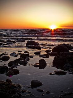 Sunset Beach, Fish Creek, Wisconsin.  A short stroll from the White Gull Inn and our after-dinner or after-fish boil destination.  There is a small cozy park with stone wall that provides a platform for viewing the sun melting into Green Bay.