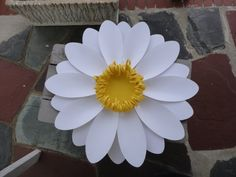 Large Paper Daisy Extra Large Paper Flower and Daisies    1-large 20-22 daisy with a pink center  6-4 daisies with a pink center        ***Your flower will be made fresh in your colors.***