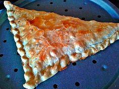 Triángulo de atún y cebolla caramelizada