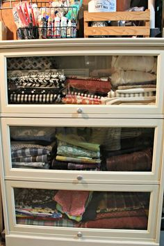 Love this fabric storage in a glass front bookcase...see your whole stash, but keep it dust free!