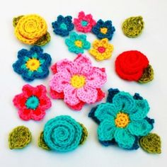 Crochet Pattern - Flower Shower (4 flowers embellishments and leaves) - LoveItSoMuch.com