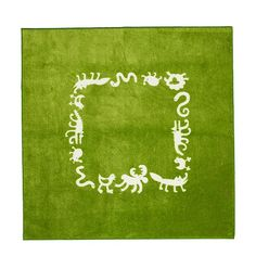 green square rug with animals