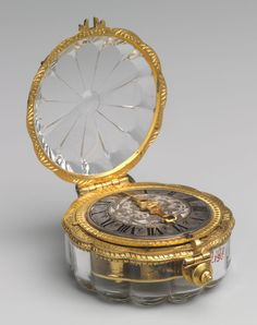СТАРИННЫЕ ЧАСЫ - Интересное и забытое - быт и курьезы прошлых  -- Watch, ca. 1650-60 Movement by Jean Rousseau the Younger (Swiss, 1606-1684) Case: rock crystal mounted in gilded brass; Dial: silver, with single gilded brass hand; Movement: gilded brass and steel, partly blued эпох.