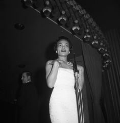 """eartha-kitts: """"Eartha Kitt performing at the Mocambo ca. Photographed by David Sutton. Courtesy of archives. Eartha Kitt, Love Warriors, Jazz Artists, Vintage Glamour, Black History, Light In The Dark, White Dress, Celebs, Actresses"""