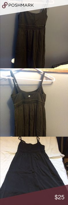 Lululemon Dress Size 6 Lululemon Black Dress Size 6, used condition with some fading from washing and wear but still has some life left, built in bra without pads, adjustable straps, has pockets!! lululemon athletica Dresses