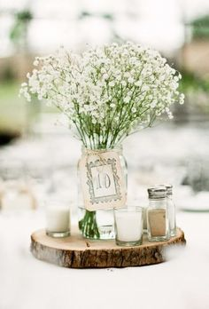 Mason Jar Centerpieces - Ideas for wedding reception centerpieces using mason jars.here're some creative ways you can utilize the mason jar to create beautifully elegant centerpieces for any wedding theme you have in mind! Wedding Flower Arrangements, Wedding Flowers, Wedding Bride, Floral Arrangements, Diy Wedding, Decor Wedding, Diy Flowers, Fall Wedding, Dream Wedding