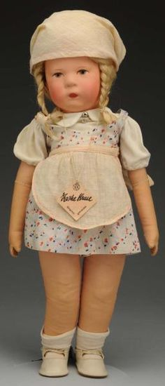 Kathe Kruse Child Doll.  1930. Doll IH with blonde human hair wig, thickly painted features, gray painted eyes, rosy cheeks; jointed shoulders and hips;