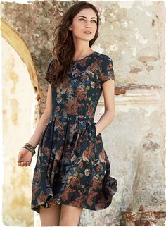 Autumn wildflowers are printed on our indigo pima (97%) and Lycra (3%) jersey dress. Everyday useful and wonderfully packable. Rounded neck; slim bodice; full pleated skirt with pockets; exposed back zipper.
