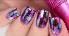 This DIY nail art tutorial will give you the metallic watercolor nails of your dreams.