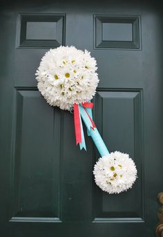 Cute baby shower idea - baby rattle made of flowers for the door!