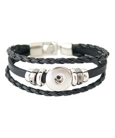 Bright Eyes Boutique Silvertone & Black Leather Large Interchangeable Snap Bracelet | zulily  . $14.99 $25.00  . : Product Description:  This accessory offers endless creative possibilities with its interchangeable snap setting, ready to embrace whatever charm suits your mood.      Snap charm not included  .     Fits 18 mm to 20 mm snap charms  .     20 cm L  .     Snap lock clasp  .     Zinc alloy / leather  .     Imported