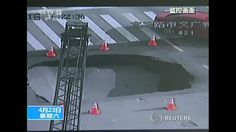 State media releases surveillance video showing a sinkhole appearing in the middle of a busy intersection in eastern China.