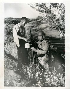 1937- Chinese civilian pours tea for Japanese soldier in a field in Peiping, China.