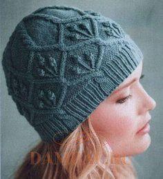 Очень миленькая шапочка :-) Вроде как и простые узоры, а смотрится очень хорошо :-)