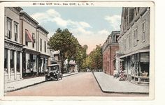 Sea Cliff NY. Sea Cliff Ave looking west toward Memorial Park;  Barber Pole & old car.  Note the building on the left side which was the Sea Cliff Market and is now Sherlock Homes real estate office. Postcard | eBay