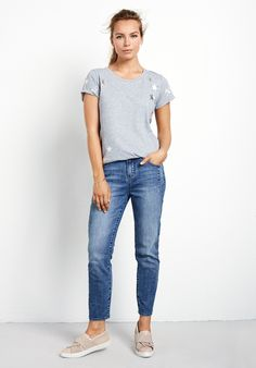 """Make metallics casual with this laid back star print tee. Wear with Boyfriend jeans for a carefree, weekend look. •Metallic star print. •Relaxed fit. Try your usual size. •Scoop neck and capped sleeves. •Model is 5'7"""" and wears size XS."""