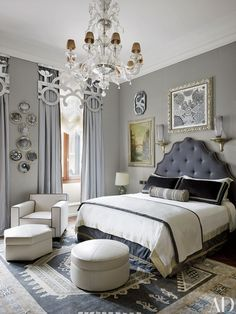 A framed 1960s Hermès scarf hangs above the bed, and vintage Fornasetti plates are displayed between the windows.