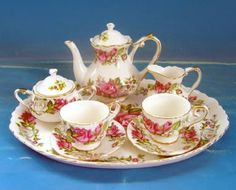 Princess Pink Child's Tea Set in Gift Box Luscious Roses! We found these at the World Tea Expo and fell in love! This Porcelain Tea Set comes with a 3-4 inch teapot, 2 teacups with saucers, creamer se