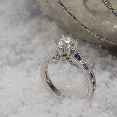 Traditional sapphires add beautiful detail to this engagement ring. #ShaneCo