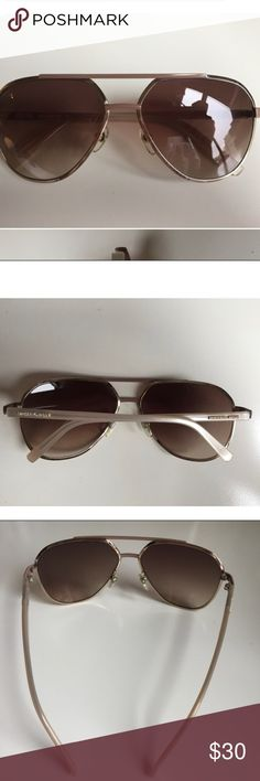 Michael Kors Brown Aviator Sunglasses Michael Kors aviator sunglasses are in good condition! Worn a couple of times and there are a few faint scratches but they do not affect the way you see out of the glasses. Michael Kors Accessories Sunglasses