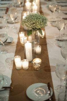 Rustic inspired tablescape of burlap, candles + baby's breath I Ben Elsass Photography I http://www.weddingwire.com/wedding-photos/real-weddings/illinois-fall-art-center-wedding/i/5b77527c35327c6a-98367c99ee78e50a/b799faea08d3a2b1