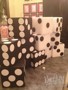 DIY dice... these would be great to set serving trays on for the buffet We could also make some super large ones for the entry or photo background.