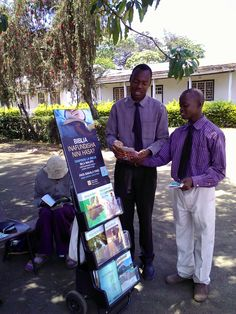 Two of our young pioneer brothers doing public witnessing near a local showground.  They set up chairs and the man behind the cart has started to read the literature right there.