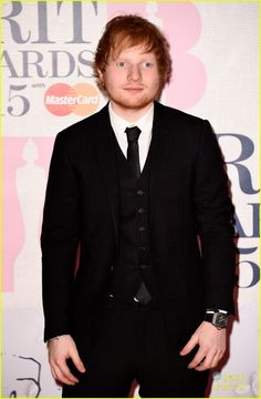 Ed Sheeran looks spiffy in a suit on the red carpet at the 2015 BRIT Awards held at The O2 Arena on Wednesday (February 25) in London, England.