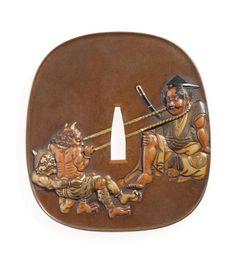 Japon, époque Edo (1603-1868), XIXe siècle. Nadegaku gata en sentoku à décor incrusté en taka zogan de cuivre, cuivre doré, shibuichi et shakudo de Rochishin assis, jouant à hubi-hiki avec deux oni sur une face, signé «Hagiya Katsuhira» suivi de «kao Mito», h. 9,2 cm. Adjugé : 10 125 € Vendredi 9 février, salle 6 - Drouot-Richelieu. Tessier & Sarrou et Associés OVV. Cabinet Portier et Associés.