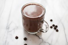 the best (coconut) hot chocolate: - 2 cans 13.5-fl-oz. coconut milk - 2 cups milk - 1 tsp vanilla - 1 12-oz. bag chocolate chips (2 cups) // I make this every year! A good basic hot chocolate recipe.