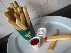 the perfect treat for the grands come April Fool's Day. Sugar cookies are cut to resemble french fries and baked to a golden brown. They are served in a container meant for french fries (willingly donated by your favorite fast food chain), alongside raspberry ketchup and 'icing' mayo.