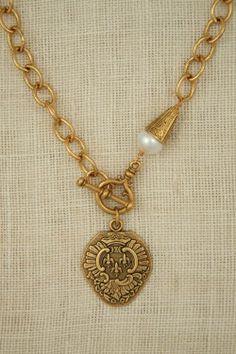 Chunky gold necklace with antique Fleur de Lis pendant by ExVoto Vintage Jewelry www.exvotovintage.com