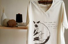 T SHIRT V NECK 100% COTTON HAND PRINT SIAMESE CAT. -------------------------------------------------------------------------------------- A cat in this picture is siam cat . she always sleep in everywhere. ● T shirt V neck cotton siam cat ● Pic print with dark brown colour ● One sided print. ● Small size (S) Shoulder : 36 cm. Chest : 40 cm. Long : 64 cm. ● Medium size (M) Shoulder : 42 cm. Chest : 47 cm. Long : 66 cm. ● Large size (L) Shoulder : 42 cm. Chest : 48 cm. Long : 69 cm. ...