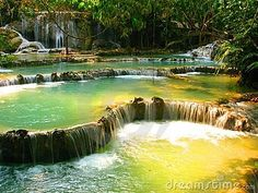 Phuang Si Waterfall in Luang Prapang, Laos. Turqouse waters extend for over 50 meters down this layered waterfall.