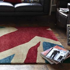 This British rug display patriotic patterns. Made up of superior quality wool, this rug is perfect comfort to the feet. They are handmade and absolutely easy to clean. #woolrugs, #easytoclean #luxuriousrugs, #therugshopuk