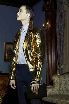 gold, metallic, biker jacket, blue pants, white buttoned up shirt, collared, zipper, pocket, masculine, rockstar style, hip, urban, david bowie from: ssense