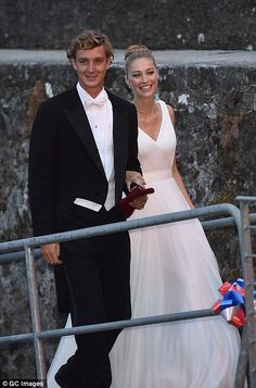 To have and to hold: Stunning Italian heiress Beatrice Borromeo is given a helping hand by her royal groom Pierre Casiraghi ahead of ceremony at her parents' lakeside castle   Daily Mail Online