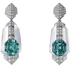 A fabulous pair of #platinum rock #crystal and #diamond earrings, with emerald cut #tourmalines by @cartier #cartier #jewelry #gems #diamonds #earrings #spectacular