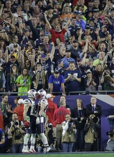 New England Patriots wide receiver Julian Edelman, left, celebrates with Danny Amendola after catching a 3-yard touchdown pass during the second half of NFL Super Bowl XLIX football game against the Seattle Seahawks on Sunday, Feb. 1, 2015, in Glendale, Ariz.