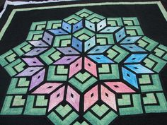 Sandy's Starburst....quilted by Charisma -- this site has many pictures of this quilt quiltingboard