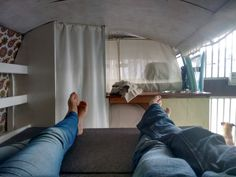 """Us in our brand new sofa bed in our finished van - Kombi. """"From a concept to right before us"""""""