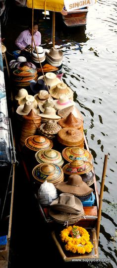 boat selling hats in Bangkok , Thailand