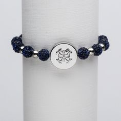 The Brandi is adorned with colorful Emerson and stainless steel beads; centered is a beautiful matching medallion with the Rustic Cuff logo.
