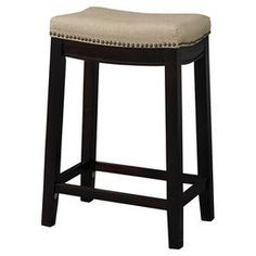 "Perfect pulled up to your kitchen island or game room table, this linen-upholstered stool showcases nailhead trim and a dark walnut finish.   Product: StoolConstruction Material: Hardwood, plywood, linen and foamColor: Dark walnut and beigeFeatures: Nailhead trim  Dimensions: Counter Stool: 24"" H x 18"" W x 12"" DBarstool: 30"" H x 18"" W x 12"" D"
